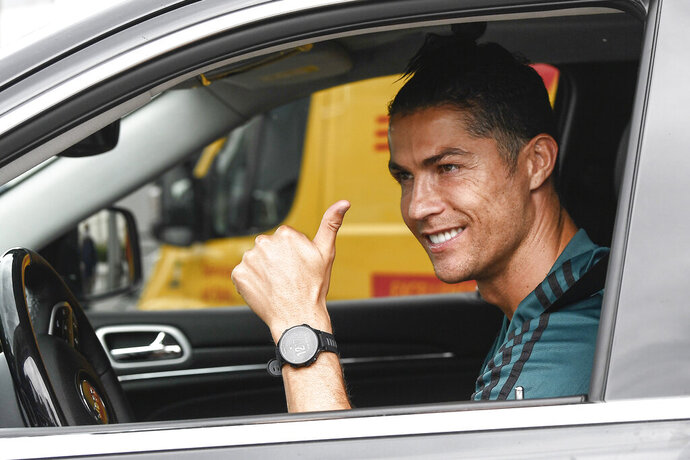 Cristiano Ronaldo leaves the Juventus sport center after his first training, in Turin, Italy, May 19, 2020. Cristiano Ronaldo has reported back to Juventus' training center after a 10-week absence. The five-time Ballon d'Or winner showed up for medical tests with the Serie A leader Tuesday, May 19, 2020. Ronaldo observed a two-week isolation period at his home in Turin after spending the lockdown period in his native Portugal. (Fabio Ferrari/LaPresse via AP)