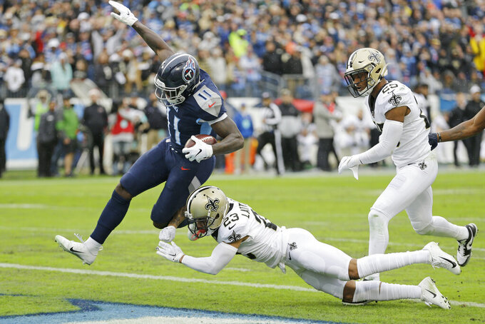Tennessee Titans wide receiver A.J. Brown (11) gets into the end zone past New Orleans Saints cornerback Marshon Lattimore (23) as Brown scores a touchdown on a 49-yard run in the first half of an NFL football game Sunday, Dec. 22, 2019, in Nashville, Tenn. (AP Photo/James Kenney)