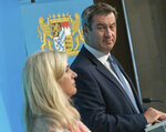 Melanie Huml, Health Minister of the German state of Bavaria, left, and Bavaria's governor Markus Soeder, right, address the media during a joint press conference in Munich, Germany, Thursday, Aug. 13, 2020. (Peter Kneffel/dpa via AP)