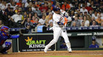 Houston Astros' Yuli Gurriel, right, hits a home run as Texas Rangers catcher Jose Trevino reaches for the pitch during the fifth inning of a baseball game Tuesday, Sept. 17, 2019, in Houston. (AP Photo/David J. Phillip)