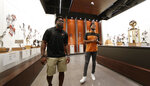 Former Texas football players Brian Orakpo, left, and Derrick Johnson, right, visits the Frank Denius Family University of Texas Athletics Hall of Fame, Friday, Aug. 30, 2019, in Austin, Texas. Displays honor all 55 of Texas' National Championship teams, 599 conference team titles, hundreds of individual national champions, 171 Olympians at 21 Olympiads, academic All-Americans and other scholastic honorees, as well as the traditions and tales that encompass the history of Longhorns. (AP Photo/Eric Gay)