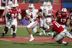 Wisconsin wide receiver A.J. Taylor (4) runs the ball past a tackle attempt by Nebraska safety Marquel Dismuke (19) during the first half of an NCAA college football game in Lincoln, Neb., Saturday, Nov. 16, 2019. (AP Photo/Nati Harnik)