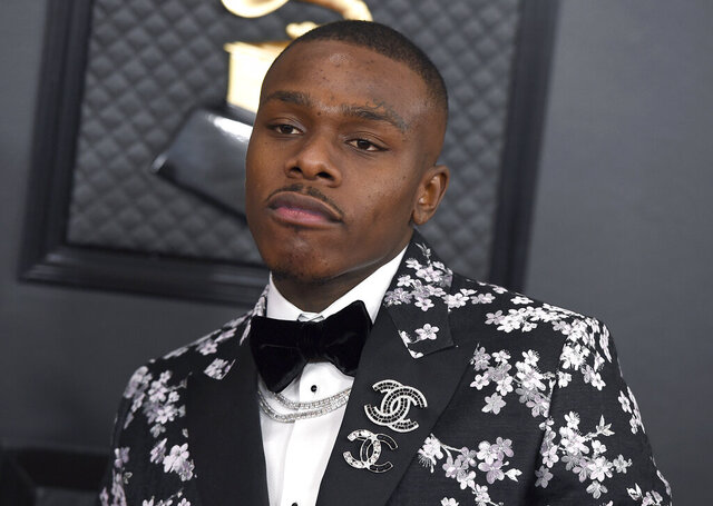 FILE - DaBaby arrives at the 62nd annual Grammy Awards on Jan. 26, 2020, in Los Angeles. The Grammy-nominated rapper has been released from a Los Angeles County jail after an arrest in Beverly Hills, Calif., where police said he took a loaded gun into an upscale store on Rodeo Drive. (Photo by Jordan Strauss/Invision/AP, File)