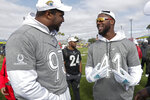 AFC defensive ends Calais Campbell, left, and Josh Allen, both of the Jacksonville Jaguars, talk during a practice for the NFL Pro Bowl football game Wednesday, Jan. 22, 2020, in Kissimmee, Fla. (AP Photo/John Raoux)