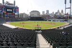 FILE - In this Friday, July 10, 2020, file photo, the Detroit Tigers play an intrasquad baseball game, in Detroit. The Tigers will play soon at Comerica Park, one of three sporting venues clustered within a mile of each other in the Motor City. With professional teams from four major leagues playing so close to each other, downtown Detroit is unique. And, that makes the COVID-19 pandemic hit a little harder here. For businesses in the area it has lately been a bust for those banking on a revenue stream from fans. (AP Photo/Carlos Osorio, File)