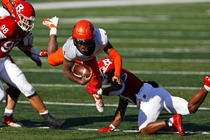 Illinois quarterback Isaiah Williams (1) is tripped up by Rutgers defensive back Christian Izien during the first half of an NCAA college football game Saturday, Nov. 14, 2020, in Piscataway, N.J. (AP Photo/Adam Hunger)