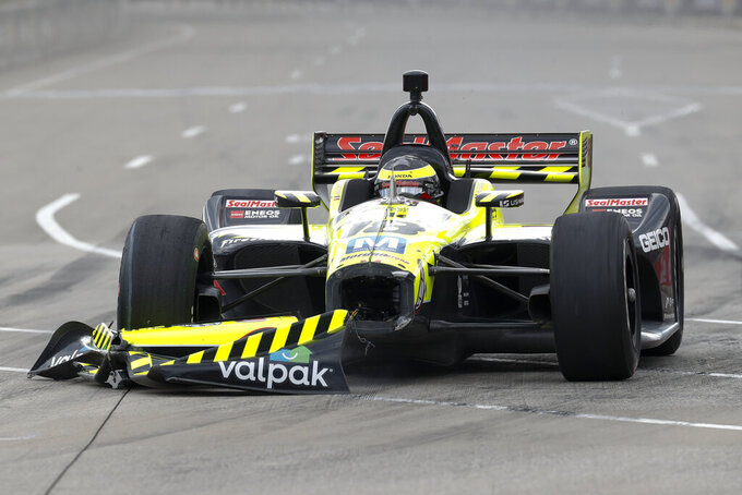 Sebastien Bourdais, of France, shows damage to his car during the second race of the IndyCar Detroit Grand Prix auto racing doubleheader in Detroit, Sunday, June 2, 2019. (AP Photo/Paul Sancya)