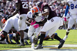 Florida running back Nay'Quan Wright (6) fights his way past Texas A&M linebacker Andre White Jr. (32) for a touchdown during the second quarter of an NCAA college football game, Saturday, Oct. 10, 2020, in College Station, Texas. (AP Photo/Sam Craft)