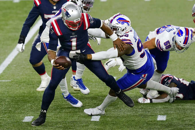 Buffalo Bills defensive tackle Quinton Jefferson, right, sacks New England Patriots quarterback Cam Newton (1) in the first half of an NFL football game, Monday, Dec. 28, 2020, in Foxborough, Mass. (AP Photo/Elise Amendola)
