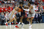 Illinois' Ayo Dosunmu, center, tries to dribble between Ohio State's C.J. Walker, left, and Andre Wesson during the first half of an NCAA college basketball game Thursday, March 5, 2020, in Columbus, Ohio. (AP Photo/Jay LaPrete)