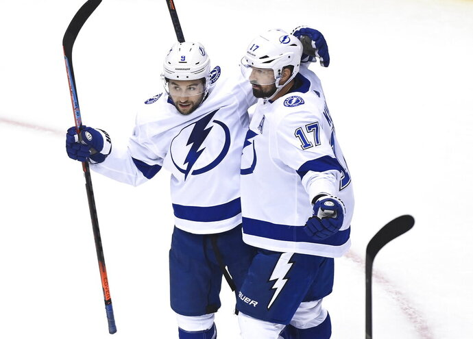 Tampa Bay Lightning left wing Alex Killorn (17) celebrates his goal with teammate Tyler Johnson (9) while playing against the Boston Bruins during the first period of an NHL hockey playoff game  Wednesday, Aug. 5, 2020 in Toronto. (Nathan Denette/The Canadian Press via AP)