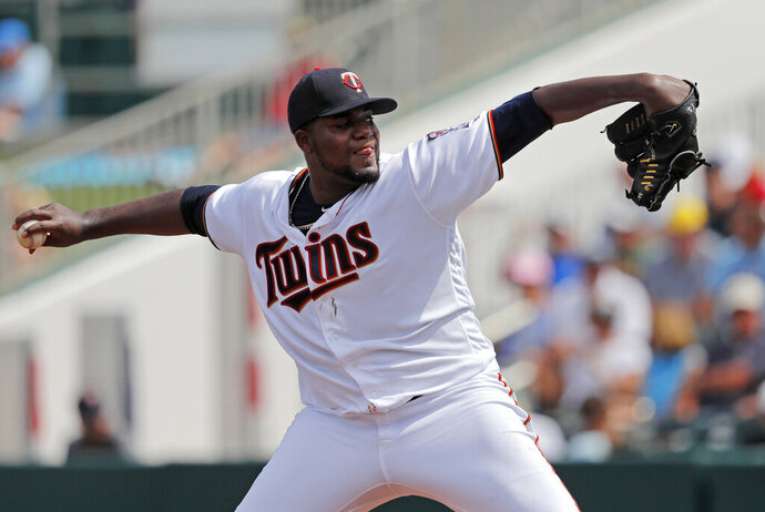 Minnesota Twins starting pitcher Michael Pineda throws in the second inning of their spring training baseball game against the Boston Red Sox in Fort Myers, Fla., Friday, March 1, 2019. (AP Photo/Gerald Herbert)