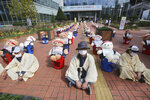 Street vendors sit to protest against a crackdown on illegal street vendors, in front of the Mapo ward office in Seoul, South Korea, Thursday, Sept. 24, 2020. They replaced protestors with teddy bears to avoid the violation of an ongoing ban on rallies with more than 10 people amid the coronavirus pandemic. The signs read: