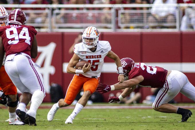 Mercer quarterback Carter Peevy (15) runs past Alabama linebacker Drew Sanders (20) during the first half of an NCAA college football game, Saturday, Sept. 11, 2021, in Tuscaloosa, Ala. (AP Photo/Vasha Hunt)