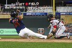 Washington Nationals catcher Yan Gomes, right, tags out Minnesota Twins' Willians Astudillo on a fielder's choice at the plate in the second inning of a baseball game Thursday, Sept. 12, 2019, in Minneapolis. (AP Photo/Jim Mone)