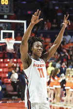 Illinois' Ayo Dosunmu (11) celebrates a 78-76 win over Iowa in the second half of an NCAA college basketball game Sunday, March 8, 2020, in Champaign, Ill. (AP Photo/Holly Hart)