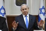 Israeli Prime Minister Benjamin Netanyahu chairs the weekly cabinet meeting, in Jerusalem, Sunday, Feb. 16, 2020. (Gali Tibbon/Pool via AP)