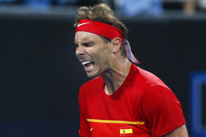 Rafael Nadal of Spain reacts to a point against Alex de Minaur of Australia during their ATP Cup tennis match in Sydney, Saturday, Jan. 11, 2020. (AP Photo/Steve Christo)