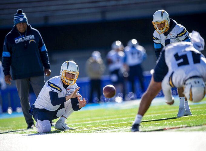 Los Angeles Chargers punter Ty Long (1) practices during the Chargers high altitude practice at the Falcons Stadium at the United States Air Force Academy in Colorado Springs, Colo., on Tuesday, Nov. 12, 2019. The Chargers arrived in Colorado Springs on Monday and will spend the week practicing at the higher altitude at the Air Force Academy in preparation for next week's game in Mexico City against the Kansas City Chiefs. (Chancey Bush/The Gazette via AP)