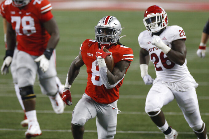 Ohio State running back Trey Sermon runs for a first down against Rutgers during the second half of an NCAA college football game Saturday, Nov. 7, 2020, in Columbus, Ohio. Ohio State won 49-27. (AP Photo/Jay LaPrete)