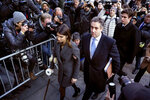 FILE - In this Dec. 12, 2018, file photo, Michael Cohen, center, President Donald Trump's former lawyer, accompanied by his children Samantha, left, and Jake, right, arrives at federal court for his sentencing in New York. A judge confirmed in a court filing Thursday, Feb. 7, 2019, that federal prosecutors in New York are still investigating campaign finance crimes committed when President Donald Trump's former lawyer, Michael Cohen, paid two women to stay silent about alleged affairs with Trump.  (AP Photo/Craig Ruttle, File)