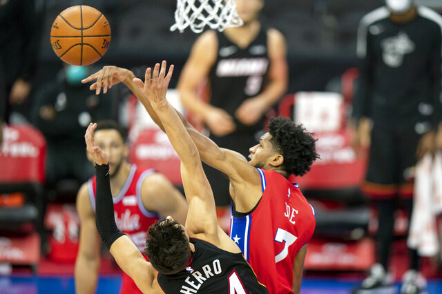 Philadelphia 76ers' Isaiah Joe, right, blocks the shot by Miami Heat's Tyler Herro, left, during the first half of an NBA basketball game, Thursday, Jan. 14, 2021, in Philadelphia. (AP Photo/Chris Szagola)