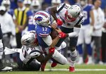 New England Patriots defenders Jonathan Jones (31) and Duron Harmon (21) tackle Buffalo Bills quarterback Josh Allen (17) in the second half of an NFL football game, Sunday, Sept. 29, 2019, in Orchard Park, N.Y. Allen left the field after the play. (AP Photo/Ron Schwane)
