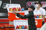 Justin Haley reaches to catch a bottle of water as he celebrates in Victory Lane after winning a NASCAR Xfinity auto race at Talladega Superspeedway in Talladega Ala., Saturday, June 20, 2020. (AP Photo/John Bazemore)