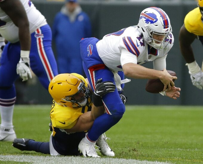 FILE - In this Sept. 30, 2018, file photo, Green Bay Packers' Kyler Fackrell sacks Buffalo Bills' Josh Allen during the second half of an NFL football game in Green Bay, Wis. The New York Giants are giving free agent linebacker Kyler Fackrell a chance to show that 2019 wasn't as bad as the numbers made it look. It's a one-year shot for Fackrell to prove his 10-1/2 sack season in 2018 with the Packers wasn't a fluke. (AP Photo/Mike Roemer, File)
