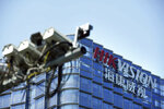 In this Wednesday, May 22, 2019, photo, surveillance cameras are seen outside the headquarters of Chinese security technology company Hikvision in Hangzhou in eastern China's Zhejiang province. Stepping up a propaganda offensive against Washington, China's state media on Friday accused the U.S. of seeking to