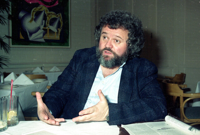 "FILE - This 1990 file photo shows director of photography Allen Daviau speaking during an interview in Los Angeles. Daviau, who shot three of Steven Spielberg's films including ""E.T. The Extra-Terrestrial,"" died Tuesday, April 14, 2020 at age 77.  (AP Photo/Julie Markes, FIle)"