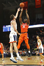 Clemson forward Aamir Simms (25) shoots over a Virginia defender during an NCAA college basketball game Wednesday, Feb. 5, 2020, in Charlottesville, Va. (Erin Edgerton/The Daily Progress via AP)