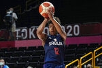 Serbia's Yvonne Anderson (12) shoots against Spain during a women's basketball game at the 2020 Summer Olympics, Thursday, July 29, 2021, in Saitama, Japan. (AP Photo/Eric Gay)