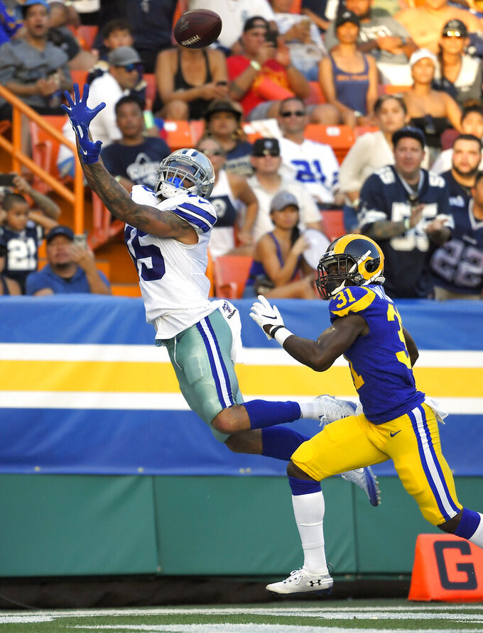 CORRECTS TO SECOND HALF INSTEAD OF FIRST HALF - Dallas Cowboys wide receiver Devin Smith, left, makes a touchdown catch as Los Angeles Rams defensive back Darious Williams defends during the second half of a preseason NFL football game Saturday, Aug. 17, 2019, in Honolulu. (AP Photo/Mark J. Terrill)