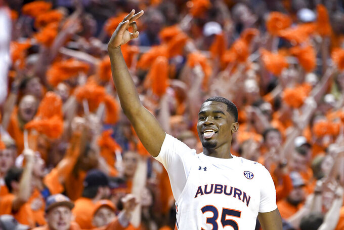 FILE - In this Feb. 12, 2020, file photo, Auburn guard Devan Cambridge celebrates a 3-point basket against Alabama during the second half of an NCAA college basketball game in Auburn, Ala. The top returning scorers for Auburn are sophomore Devan Cambridge (4.2 points) and Memphis transfer Jamal Johnson (3.5). (AP Photo/Julie Bennett, File)