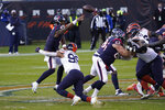 Houston Texans quarterback Deshaun Watson (4) throws as he is hit by Chicago Bears' Trevis Gipson (99) during the second half of an NFL football game, Sunday, Dec. 13, 2020, in Chicago. (AP Photo/Charles Rex Arbogast)