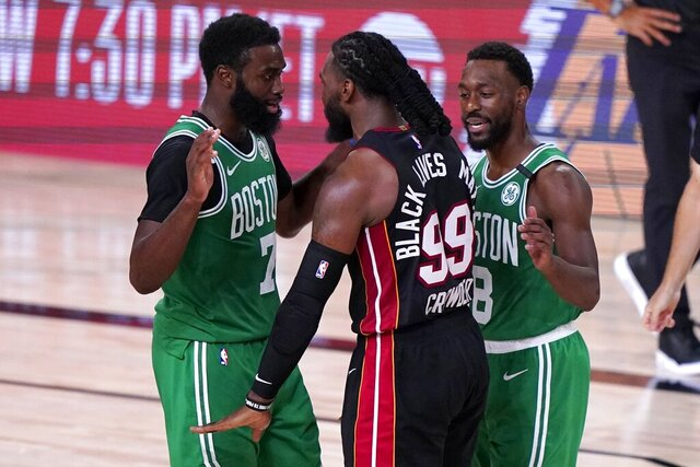 Boston Celtics' Jaylen Brown, left, and Miami Heat's Jae Crowder (99) exchange words as Kemba Walker (8) attempts to calm the situation during the second half of an NBA conference final playoff basketball game, Saturday, Sept. 19, 2020, in Lake Buena Vista, Fla. (AP Photo/Mark J. Terrill)
