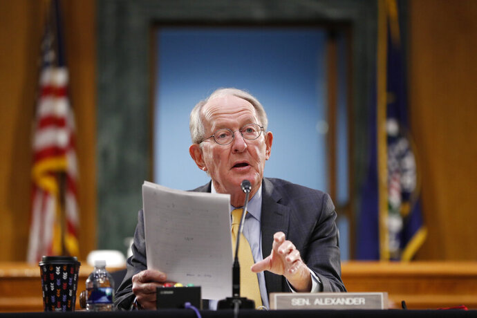 """FILE - In this May 7, 2020 file photo, Chairman Sen. Lamar Alexander, R-Tenn., gives his opening statement during a Senate Health Education Labor and Pensions Committee hearing on new coronavirus tests on Capitol Hill in Washington. The Republican Senate Health committee chairman says the Trump administration should provide President-elect Joe Biden access to transition materials -- particularly on COVID vaccine distribution --- """"to ensure a smooth"""" transfer of power.  (AP Photo/Andrew Harnik, Pool)"""