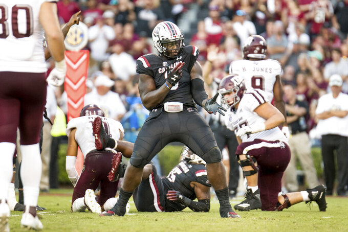 South Carolina defensive lineman Javon Kinlaw (3) celebrates a play during the second half of an NCAA college football game against Texas A&M Saturday, Oct. 13, 2018, in Columbia, S.C. Texas A&M defeated South Carolina 26-23. (AP Photo/Sean Rayford)