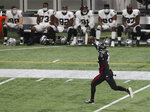 "The Las Vegas Raiders bench watches as Atlanta Falcons linebacker Deion Jones intercepts a Derek Carr pass and returns it for a touchdown during the third quarter of an NFL football game on Sunday, Nov 29, 2020, in Atlanta. (Curtis Compton""/Atlanta Journal-Constitution via AP)"