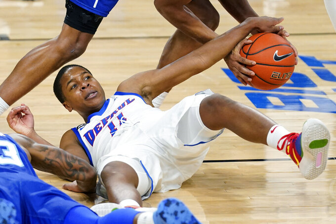 DePaul guard Charlie Moore battles for a loose ball against Seton Hall guard Jared Rhoden during the second half of an NCAA college basketball game in Chicago, Saturday, Jan. 9, 2021. (AP Photo/Nam Y. Huh)