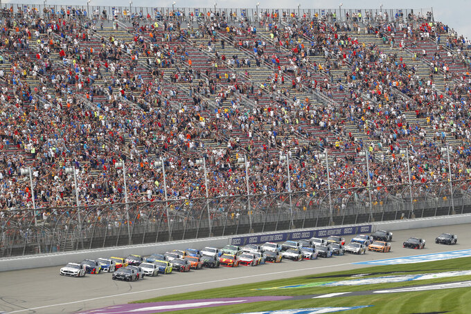 The field lines up for the start of a NASCAR Cup Series auto race at Michigan International Speedway in Brooklyn, Mich., Sunday, Aug. 11, 2019. (AP Photo/Paul Sancya)