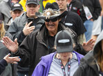 Richard Petty walks to driver introductions before a NASCAR Cup series auto race Sunday, May 5, 2019, at Dover International Speedway in Dover, Del. (AP Photo/Jason Minto)