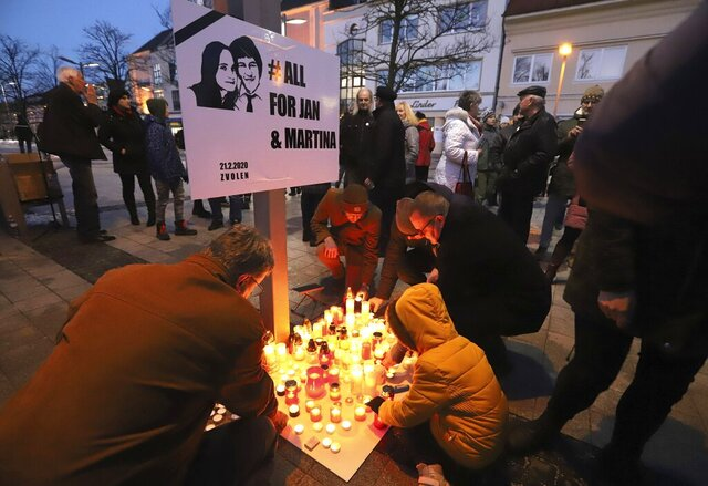 People attend a commemoration in Kosice, Slovakia, Friday Feb. 21, 2020, to mark the second anniversary of the slayings of an investigative reporter and his fiancee. Jan Kuciak and Martina Kusnirova were shot dead in their home. The killings triggered major street protests and a political crisis that led to the dismissal of the national police chief and the government's collapse. (Roman Hanc/TASR via AP)