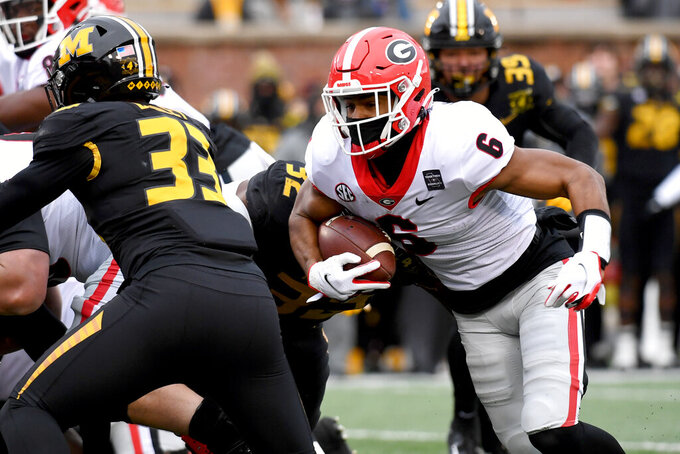 Georgia running back Kenny McIntosh (6) runs with the ball during the first half of an NCAA college football game against Missouri Saturday, Dec. 12, 2020, in Columbia, Mo. (AP Photo/L.G. Patterson)