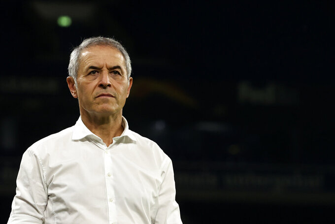 FC Basel's head coach Marcel Koller addresses the media after the Europa League quarter finals soccer match between FC Shakhtar Donetsk and FC Basel at the Veltins-Arena in Gelsenkirchen, Germany, Tuesday, Aug. 11, 2020. (Wolgang Rattay/Pool Photo via AP)