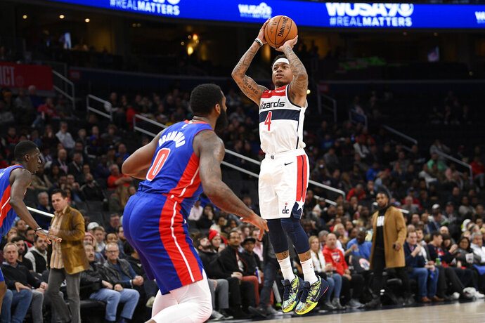 Washington Wizards guard Isaiah Thomas (4) shoots in front of Detroit Pistons center Andre Drummond (0) during the second half of an NBA basketball game, Monday, Nov. 4, 2019, in Washington. (AP Photo/Nick Wass)