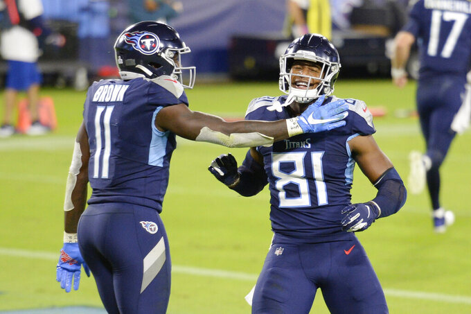 Tennessee Titans tight end Jonnu Smith (81) is congratulated by wide receiver A.J. Brown (11) after Smith caught a touchdown pass against the Buffalo Bills in the second half of an NFL football game Tuesday, Oct. 13, 2020, in Nashville, Tenn. (AP Photo/Mark Zaleski)