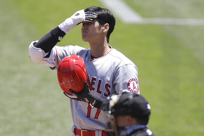 Los Angeles Angels' Shohei Ohtani reacts in the first inning of a baseball game against the Oakland Athletics, Monday, July 27, 2020, in Oakland, Calif. (AP Photo/Ben Margot)
