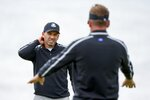 Team Europe's Sergio Garcia talks to Team Europe's Ian Poulter on the sixth hole during a practice day at the Ryder Cup at the Whistling Straits Golf Course Thursday, Sept. 23, 2021, in Sheboygan, Wis. (AP Photo/Charlie Neibergall)